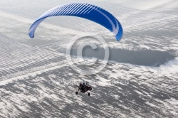 Aerial view paramotor buggy or motorized paraglider seen from th